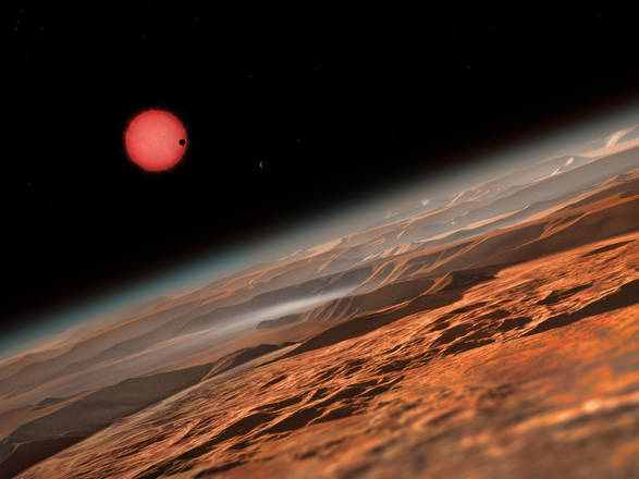 Ricostruzione artistica del panorama su uno dei tre pianeti in orbita intorno alla stella Trappist-1 (fonte: ESO/M. Kornmesser)